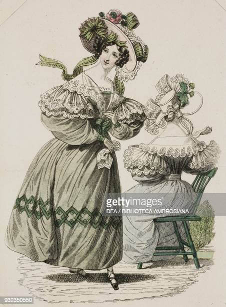 Woman wearing a light green dress with puffed sleeves Greek meanders lace and lightcoloured hat adorned with flowers and green ribbons and a woman...