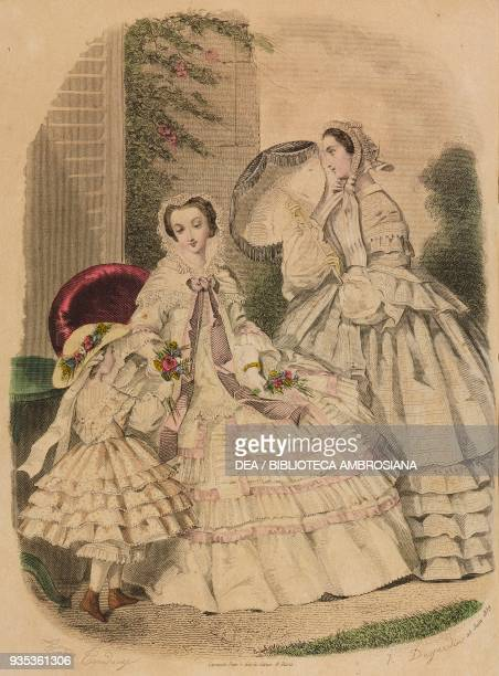 Woman wearing a light indoor dress teenage girl wearing a city dress and holding an umbrella fivesix yearold girl wearing a muslin dress engraving by...