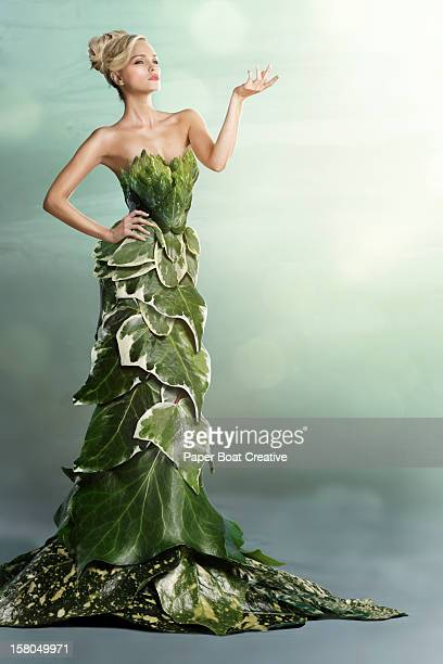 woman wearing a long gown made of leaves - strapless evening gown stock pictures, royalty-free photos & images