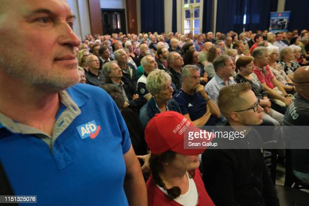 A woman wearing a Make America Great Again cap attends an election campaign rally of the rightwing Alternative for Germany political party prior to...