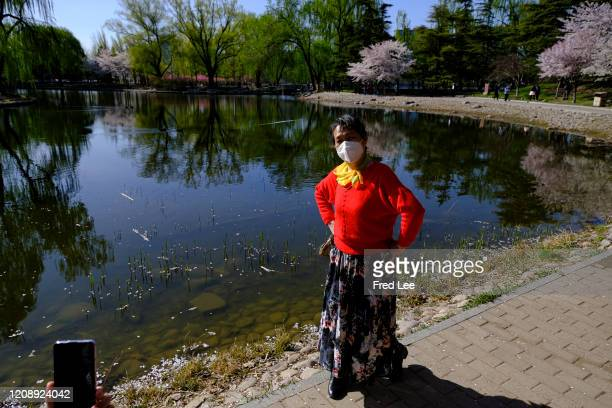 Woman wearing a mask as part of precautionary measures against the spread of the COVID19 on April 02 2020 in Beijing China Health authorities of...