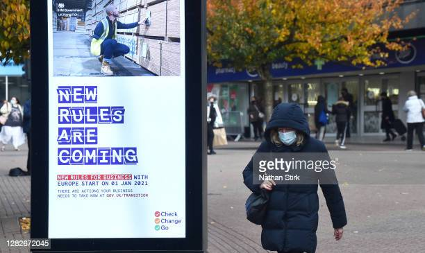 Woman wearing a mask is seen shopping in Hanley as Staffordshire prepares to move into Tier 2 COVID-19 on October 28, 2020 in Stoke-on-Trent,...