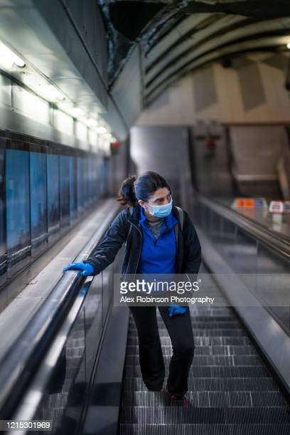 woman wearing a mask on the london subway or tube - commuter stock pictures, royalty-free photos & images