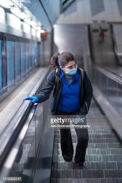 woman wearing a mask on the london subway or tube - railway station stock pictures, royalty-free photos & images