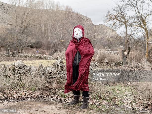 A woman wearing a mask poses for a portrait as she takes part in a carnival in the village of Luzon on February 14 2015 near Molina de Aragon Spain...