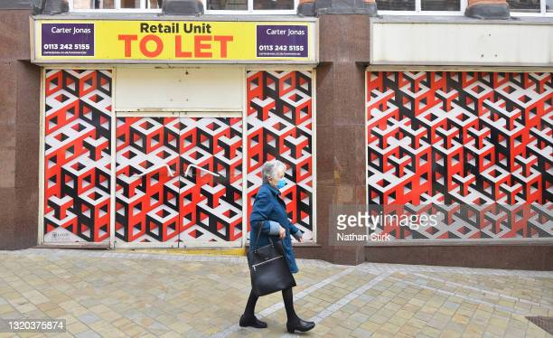 Woman wearing a mask walks past a retail unit to let on May 27, 2021 in Leeds, England.