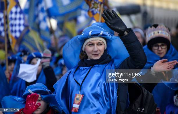 A woman wearing a medieval style costume seen taking part in the Epiphany procession also know as Three Kings Day The Catholic feast day remembered...