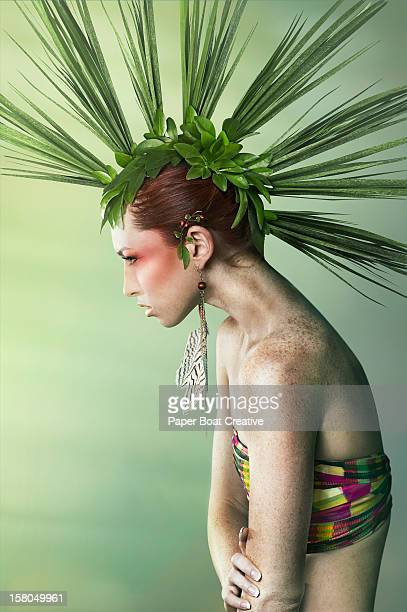 Woman wearing a mohawk made of leaves
