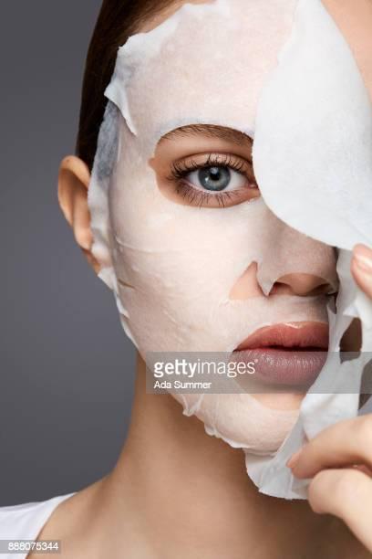 woman wearing a moisturizing sheet mask