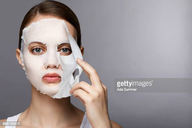 woman wearing a moisturizing sheet mask