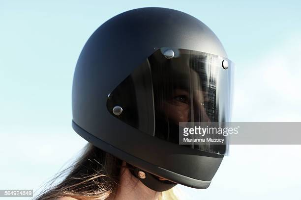 woman wearing a motorcycle helmet - crash helmet stock pictures, royalty-free photos & images