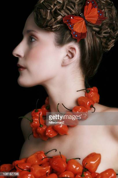 Woman Wearing a Necklace of Peppers