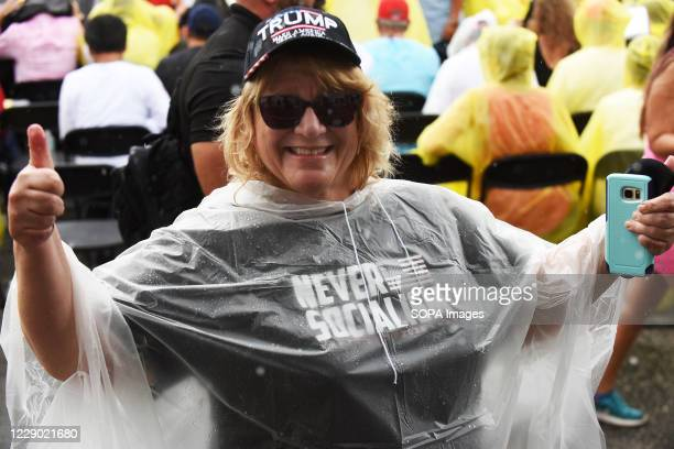 Woman wearing a Never Socialism t-shirt gives a thumbs up while waiting for Donald Trump Jr to speak at a Fighters Against Socialism campaign rally...