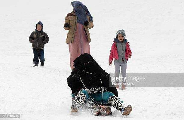 Woman wearing a niqab descends down on a slope on a sled at the Oukaimeden ski resort, in the Atlas Mountains, 30 kilometres from the popular tourist...