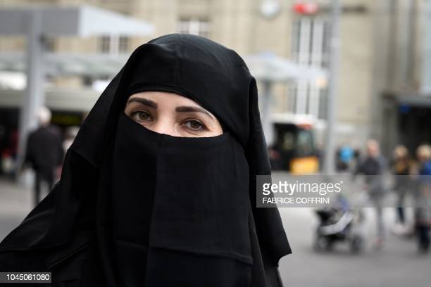 A woman wearing a niqab poses during a protest by French Algerian businessman and political activist Rachid Nekkaz in St Gallen on October 3 2018...