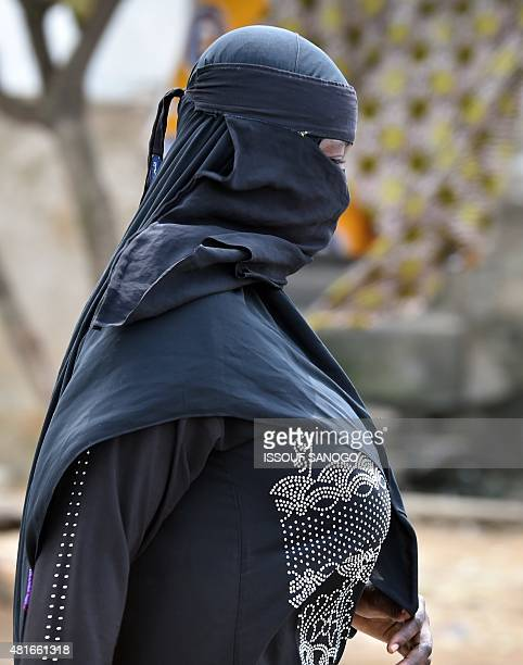 A woman wearing a niqab walks on July 23 2015 in a street of Abidjan where the full veil is not forbidden AFP PHOTO / ISSOUF SANOGO