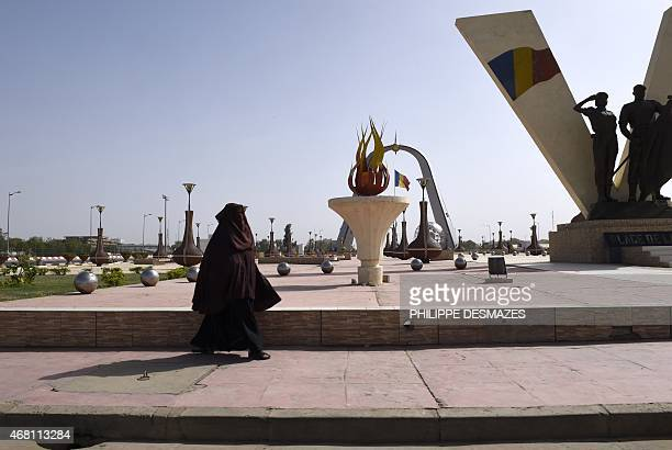 A woman wearing a niqab walks through Nation square in N'Djamena on March 30 2015 AFP PHOTO / PHILIPPE DESMAZES