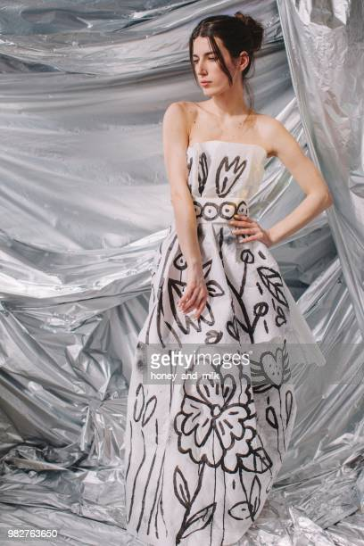 woman wearing a paper dress - strapless evening gown stock pictures, royalty-free photos & images