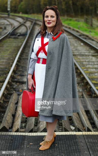 A woman wearing a period 1940's nurses uniform poses on a railway crossing during the North Yorkshire Moors Railway 1940's Wartime Weekend event on...