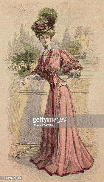 Woman wearing a pink Crepe de Chine dress silk borders pleated bodice with puffed sleeves and a hat with feather creation by Drecoll colored...