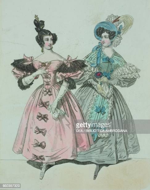 Woman wearing a pink dress with puffed sleeves gloves adorned with coloured bows and black lace and her hair styled high on her head woman wearing a...