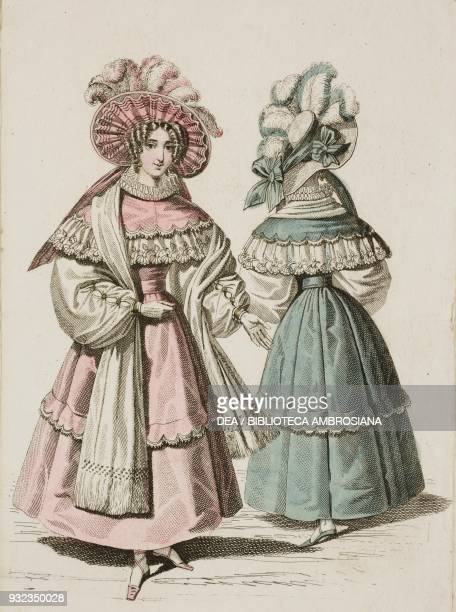 Woman wearing a pink walking dress with white lacetrimmed matching cape white stole and hat adorned with white and pink feathers and a woman wearing...