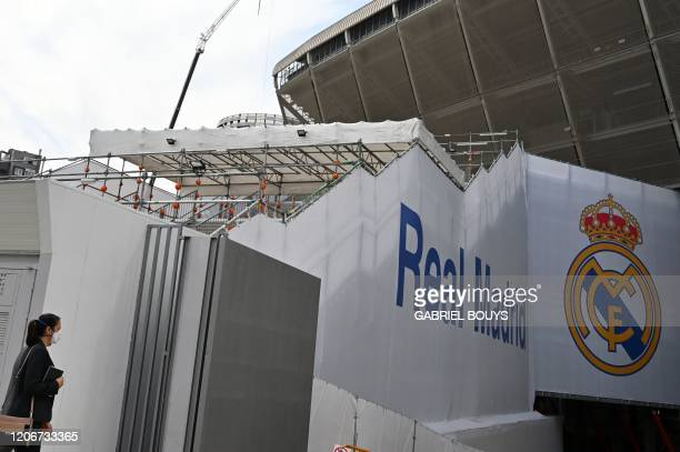Woman wearing a protective face mask arrives at the Santiago Bernabeu stadium in Madrid as Real Madrid players went into quarantine due to the...