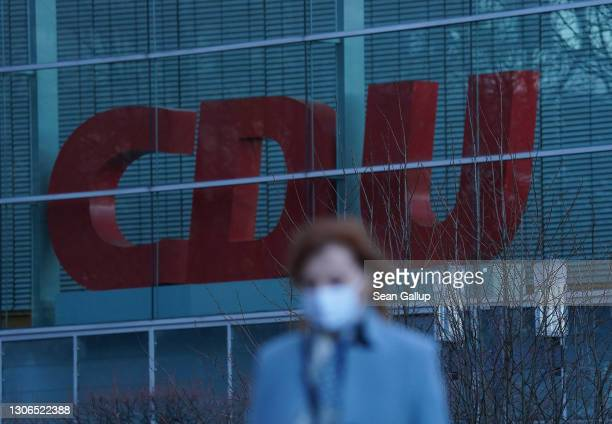 Woman wearing a protective face mask walks past the party headquarters of the German Christian Democrats on March 11, 2021 in Berlin, Germany. The...