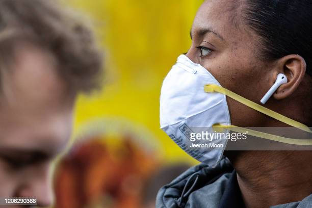 Woman wearing a protective mask is seen in Union Square on March 9, 2020 in New York City. There are now 20 confirmed coronavirus cases in the city...