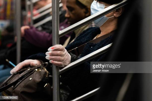 A woman wearing a protective mask rides a subway on March 9 2020 in New York City There are now 20 confirmed coronavirus cases in the city including...