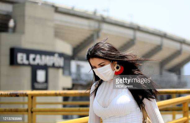 Woman wearing a protective mask walks near El Campin Stadium on March 17, 2020 in Bogota, Colombia. CONMEBOL announced today that Copa America...