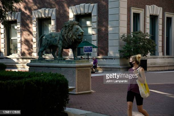 Woman wearing a protective mask walks on the campus of Columbia University during Phase 4 of re-opening following restrictions imposed to slow the...