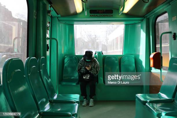 A woman wearing a protective s seen in the public transportation on February 27 2020 in Milan Italy Italy registered a 25% surge in coronavirus cases...
