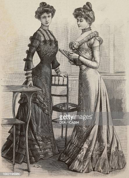 Woman wearing a purple satin dress and woman wearing a yellow crepe de Chine dress models by Mademoiselle Louise Piret engraving from La Mode...