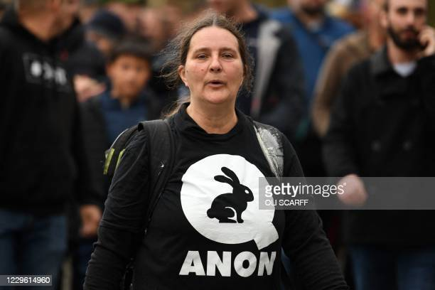 Woman wearing a QAnon slogan on her shirt attends a gathering of protesters outside St George's Hall during an anti-vax rally protest against...