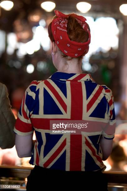 Woman wearing a red headscarf and Union Jack blouse at the Vintage Festival, held at the Royal Festival Hall in London, 31st July 2011.
