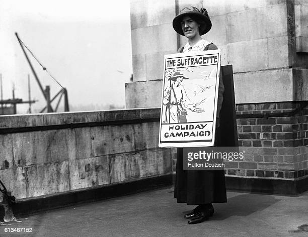 A Woman wearing a sandwich board to promote The Suffragette the journal of the Women's Social and Political Union