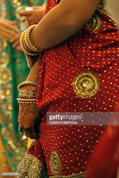 A woman wearing a saree