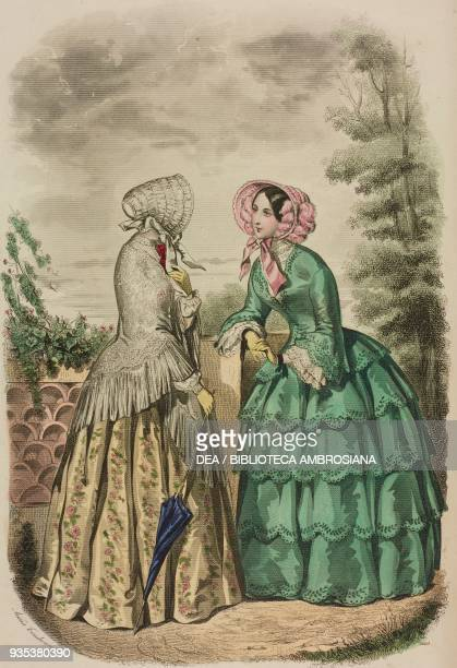 Woman wearing a satin Longchamp redingote dress and crepe de chine shawl woman wearing a green taffeta Longchamp dress with a with fivefrill skirt...