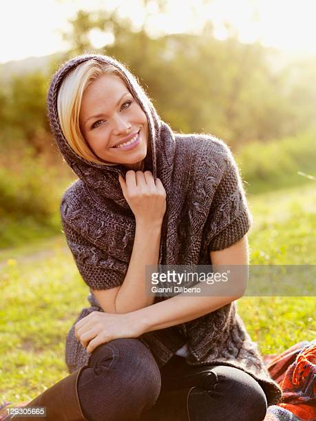 A woman wearing a shawl relaxing outdoors in the sun