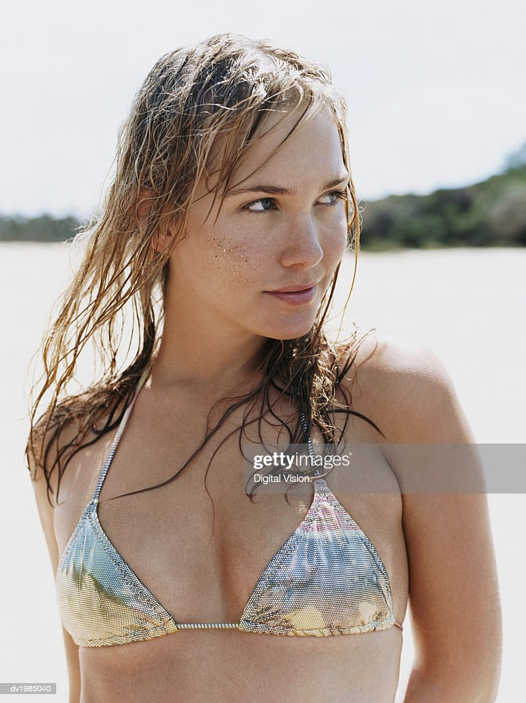 Woman Wearing a Silver Bikini Top With Sand on Her Cheek : Stock Photo