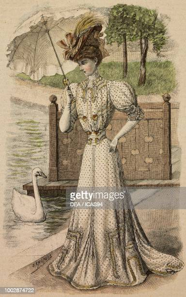 Woman wearing a Spa dress white polka dot foulard fabric lace decorations coordinated hat and parasol umbrella creation by Martial and Armand colored...