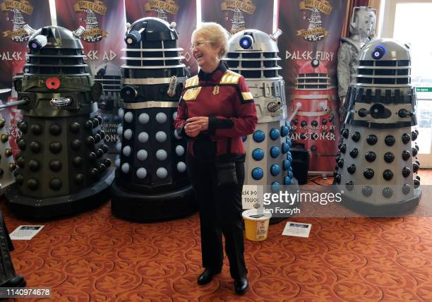 Woman wearing a Star Trek uniform stands in front of a display of Dalek's as she attends the second day of the Scarborough Sci-Fi weekend held at the...