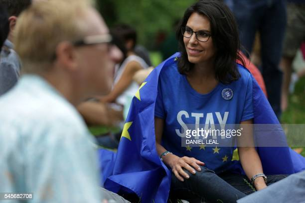 A woman wearing a 'Stay' Tshirt smiles draped in a European flag during a picnic against Brexit organised by the General Assembly in Green Park in...