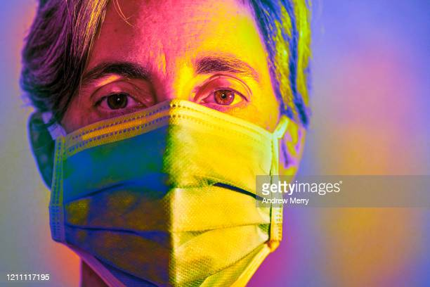 woman wearing a surgical mask, protective face mask against infectious diseases like coronavirus, covid-19 and influenza - coronavirus doctor stock pictures, royalty-free photos & images