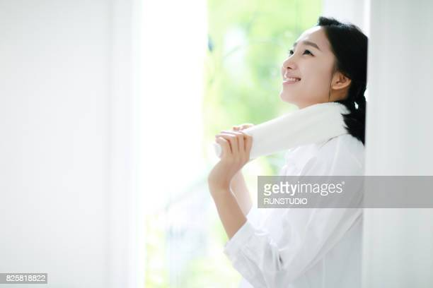 woman wearing a towel around her neck and laughing