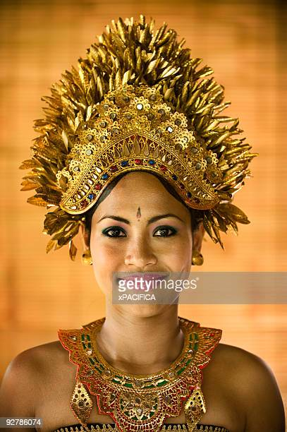 A woman wearing a traditional ceremonial headpiece