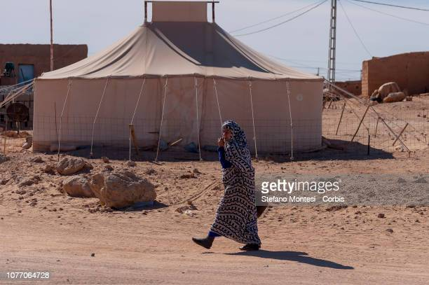 A woman wearing a traditional dress crosses the Saharawi refugee camp Auserd on January 4 2019 in Tinduf Algeria he Sahrawi refugee camps in Tindouf...
