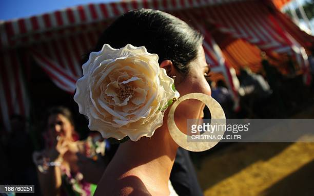 A woman wearing a traditional dress from Andalucia is seen during the Sevilla Fair on April 16 2013 The fair dates back to 1847 when it was...