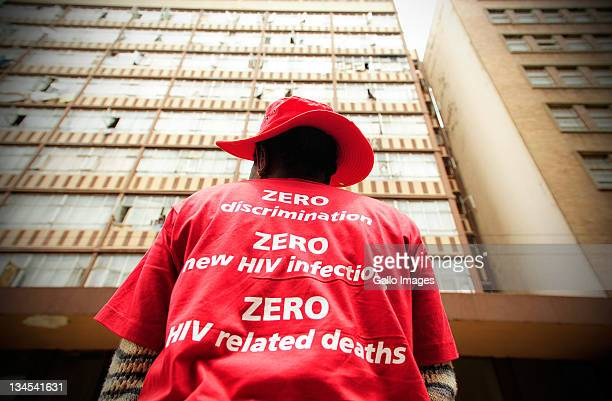 Woman wearing a t-shirt with slogans attend a city march to mark the 23rd commemoration of World Aids Day on December 1, 2011 in Johannesburg, South...